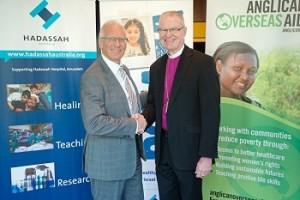 Ron Finkel shaking hands with Archbishop Freier