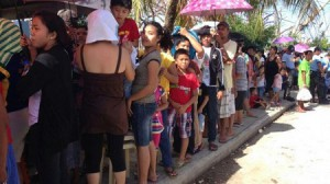 A crowd outside the newly established IDF field hospital in Bogo City, Philippines (photo credit: IDF Spokesperson's Unit)