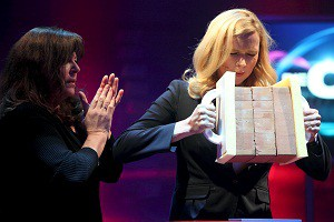 """Veronica Ferres (right), lifting heavy rocks as one of the quiz show tasks she had to perform, while her """"teammate"""" German actress, Gundi Ellert, looks on. Copyright ZDF, Frank W. Hempel"""