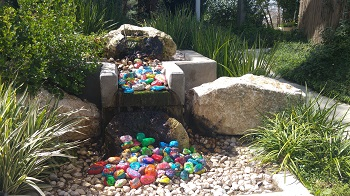 Peace stones in the fountain of the Healing Garden outside the Department for Children with Chronic Diseases